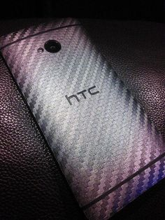 Gun Metal Carbon Fiber for the HTC One M7 from Slickwraps.com.