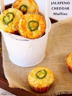 Jalapeno Cheddar Muffins. Fluffy, cheesy, golden muffins with the kick of slightly spicy jalapenos. Try them today for a snack, breakfast-on-the-go and even as a side for dinner. #happyandharried #muffins #jalapeno #cheddar #cheese #muffin #recipe