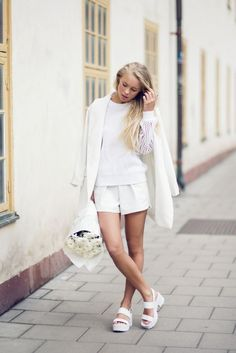 Style chunky shoes with an all-white outfit.