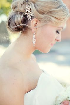 Delicate hair pin and earrings were the perfect touches to this bride's look! Wedding by Eden Harkins - DFW Events. Photo by Sarah Kate Photography. #wedding #sparkle #accessories
