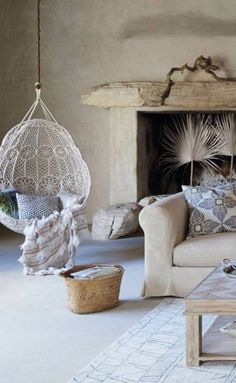 Muted colours, driftwood mantel and lace hanging chair