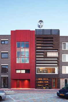 Charred wood and a bold wash of red enliven the facade of a green house in the Netherlands. Photo by Hans Peter Follmi. This originally appeared in Facade Focus: Charred Cedar. Architecture Résidentielle, Cabinet D Architecture, Contemporary Architecture, Amazing Architecture, Chinese Architecture, Wood Facade, Wood Siding, Timber Cladding, Charred Wood