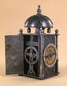 Italian, C16th, Small iron wall clock; iron case and movement; weight-driven with verge escapement and foliot; striking-train with count-wheel set at a right-angle to the train.