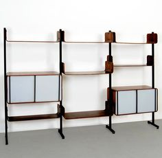 Franco Campo and Carlo Graffi; Molded Teak Plywood, Enameled Metal and Perspex Storage Unit for Home, 1950s.