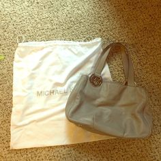 Authentic Michael Kors Shoulder Bag Authentic bag. Gray in color. Inside is clean. Bag has been used multiple times. Michael Kors Bags Shoulder Bags