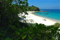 Unspoiled Freedom Beach south of Patong in Phuket island is a scenic place to relax and enjoy the beauty of a tropical beach in Thailand.