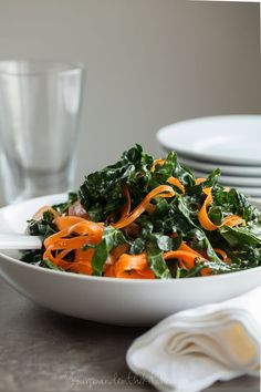 Moroccan Kale and Carrot Ribbon Salad Recipe  | Gourmande in the Kitchen  A colorful tangle of carrots and kale ribbons tossed in a spicy Moroccan inspired dressing you can twist and turn around like pasta on a fork. http://gourmandeinthekitchen.com/2016/moroccan-kale-and-carrot-ribbon-salad/