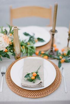 Brides.com: . A kumquat garland is the perfect colorful accent when paired with a neutral tablescape. Cute mini sprigs of the citrus fruits are a great way to decorate each setting, too!