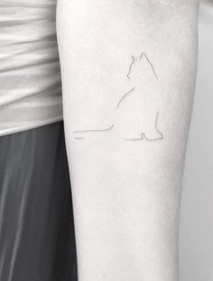 Barely-there cat tattoo by Jakub Nowicz #CatTattoo