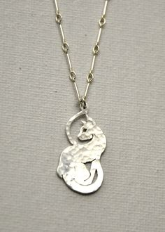 Silver Curled Cat Necklace on Etsy, $80.00