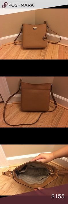 Michael Kors Jet Set Travel Large Messenger New with tags. 10 inches x 10 inches x 3 inches. Adjustable straps. Beautiful tan coated leather with gold hardware. MICHAEL Michael Kors Bags Crossbody Bags