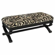 "Showcasing nailhead trim and zebra-print upholstery, this wood-framed bench makes an eye-catching addition to your parlor or hall.    Product: BenchConstruction Material: Solid wood and fabricColor: Black and tanFeatures: Nailhead trimDimensions: 20"" H x 48"" W x 21"" D"