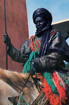 A mounted Hausa warrior in full ceremonial regalia, Nigeria 1974 Vintage Nigeria African Culture, African History, African Art, Nigerian Culture, African Tribes, African Diaspora, African Royalty, Black History Facts, Portraits