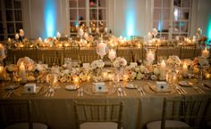 I love this. I would do white tablecloths with gold chargers or gold-trimmed china. I adore all the candles and flowers!