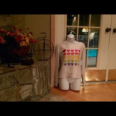 REFLEX WHITE WITH COLERD HEARTS SWEATSHIRT REALLY CUTE GENTLY PRE LOVED SWEATSHIRT 60 % COTTON 40% POLYESTER  THANK YOU SO MUCH VERY MUCH FOR VISITING MY CLOSET PLEASE COME BACK ANYTIME  ALLISON:):):) REFLEX Tops Sweatshirts & Hoodies