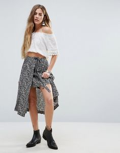 Buy it now. Free People Love Train Ditsy Print Skirt - Black. Skirt by Free People, Lightweight printed fabric, High-rise waistband, Wrap style, Regular fit - true to size, Machine wash, 98% Cotton, 2% Spandex, Our model wears a UK 8/EU 36/US 4 and is 162cm/5'3.5 tall. ABOUT FREE PEOPLE With roots back to the �70s, the Free People girl lives through art, fashion, music and wanderlust. She�s feminine in spirit and Bohemian in attitude. From sweet to tough, tomboy to romantic, Free People m...