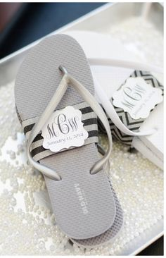 Old Navy flip flops wrapped in band with couple's monogram as wedding guest favors / dancing shoes.
