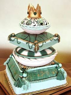 Exotic Green and white four tier Arabian wedding cake in the shape of 4 different shaped cushions, topped with a jeweled golden crown. The latest trend in trendy wedding cakes. - From www.justfab.com         ........   #wedding #cake #birthday