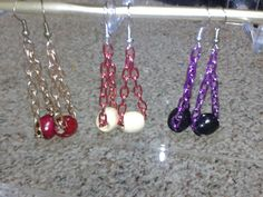 Colorful chain and wooden bead earrings!! (: new creation.