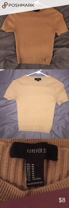 Tan ribbed forever 21 crop top Tan/beige crop top. Looks brand new only been worn once  Forever 21 Tops Crop Tops