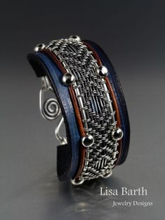 A new way of doing leather with wire work.  Handwoven wire work attached to hand made leather bracelet part.