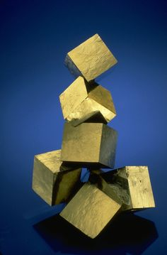 These perfect cubes, with mirror surfaces are formed naturally, and are not cut , or polished. Pyrite crystals from the National Mineral Collection