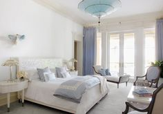 Master suite with French doors and a Fortuny chandelier, motherofpearl headboard bed and side tables designed by John Meeks  Bedroom  Modern  Transitional by Aman & Meeks