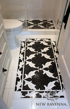 Tamara, a stone waterjet mosaic with a custom mosaic background, shown in Nero Marquina honed and Thassos polished, is part of the Silk Road Collection by Sara Baldwin for New Ravenna Mosaics.<br /> -photo courtesy of Beth Fults / Decorative Materials