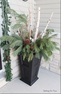 Christmas Home Tour – Home for the Holidays : Make urns with curb appeal! Decorate your winter porch with birch branches, curly willow, Large pine cones and fresh greenery. Christmas Entryway, Christmas Porch, Outdoor Christmas, Winter Christmas, Christmas Wreaths, Christmas Crafts, Country Christmas, Christmas Carol, Christmas Christmas