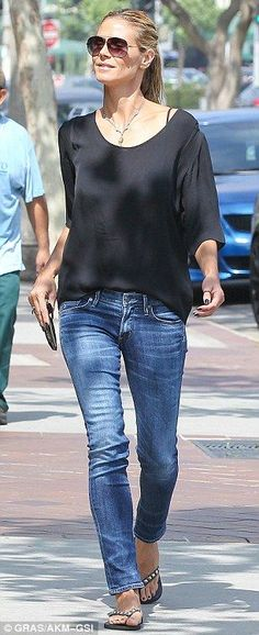 Does she ever look bad? The 41-year-old supermodel stunned in basic jeans and a black T-sh...