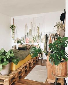 50 Dreamy Boho Bedroom Decorating Ideas - The wood-pallet bed has the uber-relaxed attitude of the emerging artist, while the plethora of plantlife keeps this Boho palace alive and thriving. Budget Bedroom, Bedroom Ideas, Bed Ideas, Wood Bedroom, Master Bedroom, Bedroom Bed, Bedroom Designs, Bedroom Furniture, Jungle Bedroom