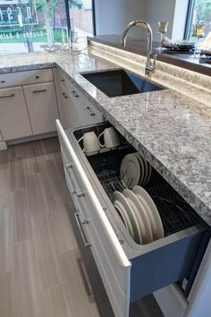 The fully concealed, extra large dish drawer sits within the island. Budget Kitchen Remodel, Kitchen On A Budget, Home Decor Kitchen, Kitchen Interior, New Kitchen, Kitchen Black, Kitchen Makeovers, Kitchen Remodeling, Modern Interior