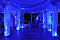Lighted columns for the dance floor created with gossamer hanging from the ceiling - uplighting can on the floor.