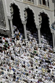 Muslim pilgrims pray outside the Grand mosque in Mecca, Saudi Arabia, Monday, Oct. 22, 2012.