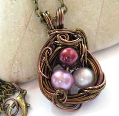 nest necklace pendant, by Sojourncuriosities. Sojourn makes some of my favorite wire-wrapped jewelry. Even the often-seen wire-wrapped-pearl nest pendants look completely unique when created by her.