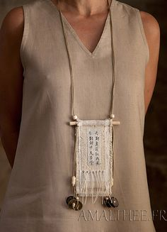 Vintage linen necklace with ethnic bone beads. I wonder what the text says...