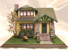 visit this site for more photos of this and other smaller scale miniatures. Fairy Houses, Doll Houses, Country Sink, Wood Mantle, All The Small Things, Dollhouse Miniatures, Wooden Dollhouse, Built In Bookcase, Brickwork