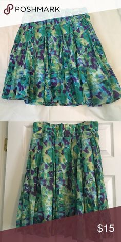 Multi Colored Spring Skirt Beautiful colors of pale yellow, green, aqua, and purple make up this skirt reminiscent of a Monet painting. Fully lined with an extra wide elastic waistband. Knee length skirt is machine washable. New Directions Skirts Midi