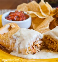 Chicken Chimichangas - Crispy outer tortilla filled with Mexican pulled chicken and a yummy white cream sauce.  So good!