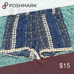 Printed fabric shorts with lace These shorts have never been worn, they have a blue print and lace on the bottom Full Tilt Shorts