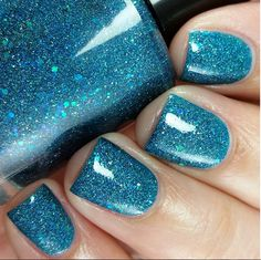 Illyria Polish: ⭐ Sirens ⭐... a blue leaning teal jelly base packed with tiny silver holo glitters, green iridescent glitters, blue flakes and blue holo glitters