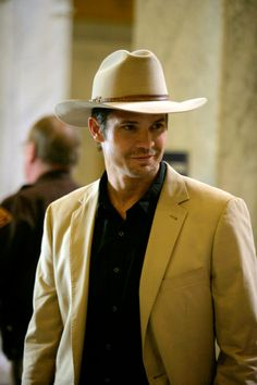 Justified. Timothy Olyphant wears his Stetson well. I never thought cowboy hats were sexy until this show.