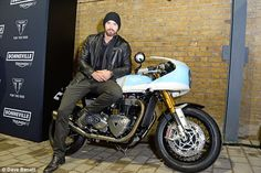 Hell for leather: Twilight hunk Kellan Lutz donned a leather jacket as he posed on one of the new Triumph cycles