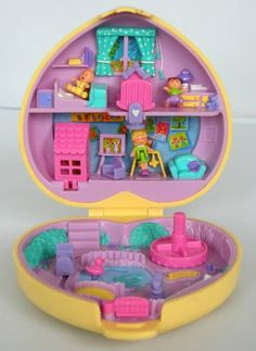 polly pocket, one of the best toys ever! They were so dang small though, you kids now have it easy because they make them big enough to change their clothes, we could barely tell if they were wearing anything because they were so minuscule!