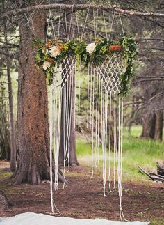 More gorgeous macrame- this time entwined with gorgeous blooms to create a backdrop for a wedding ceremony.