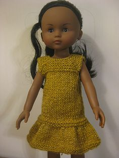 This a FREE FUN little pattern for 14inch dolls. It is a plain variation of my Hearts and Kisses for 13/14 inch dolls done in a very thin sparkly DK yarn with an added extra of a fluffy bolero and fluffy hairband.