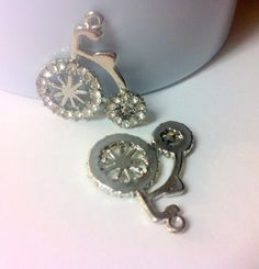 Check out this item in my Etsy shop https://www.etsy.com/ca/listing/256496593/one-silver-tone-rhinestone-bicycle-charm