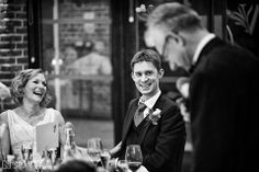Both bride and groom smile as her father makes his speech at their Wasing Park wedding