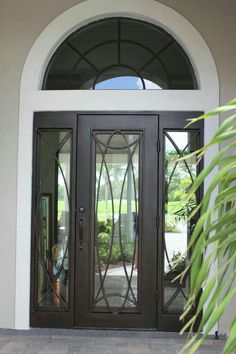 What do you usually have in mind when you think of wrought iron doors? Most people will probably associate them with fences or garden doors. Others ma. Iron Front Door, Front Door Entrance, Exterior Front Doors, Entry Doors, Front Entry, Door Gate Design, Front Door Design, Entry Door With Sidelights, Wrought Iron Doors