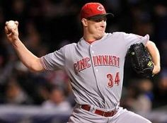 Reds starter Homer Bailey delivers during the first inning as the Reds stymie Cubs at Wrigley.